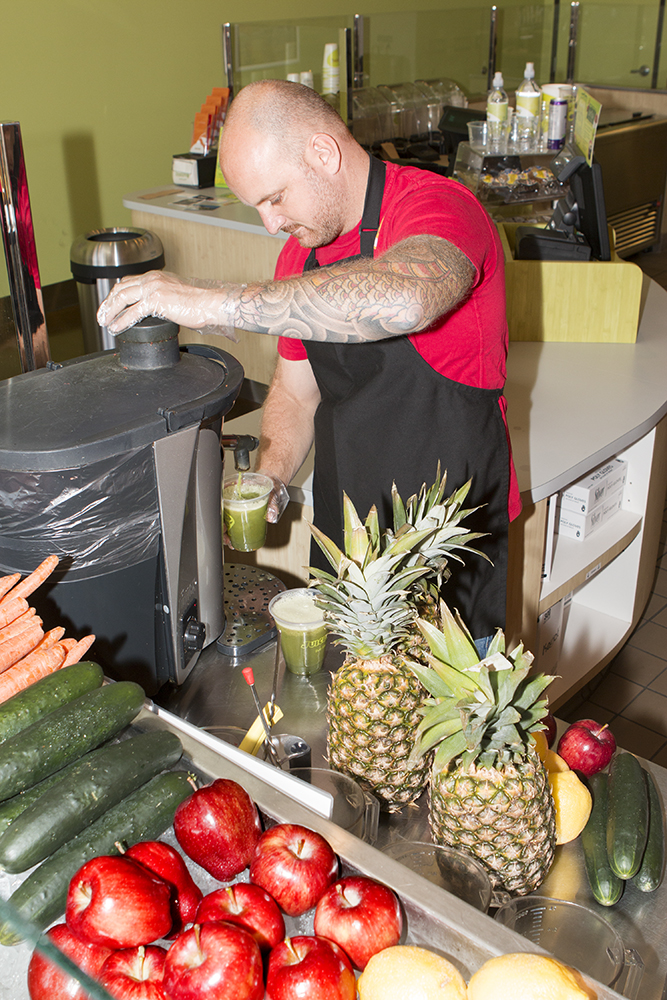 Owner Vincent Rodgers showing how to mix fruits and vegetables