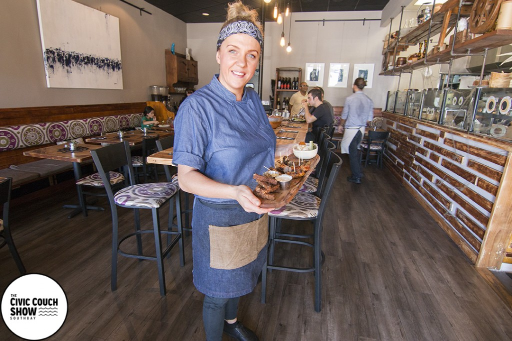 Chef Kristina Miksyte with a Grilled Sausage Board inside their new location.